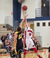 Zach Miller controls the opening jump in a JV boys basketball win over Welllington Napoleon.