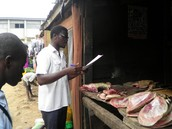 Adedayo Ashimolowo - a Literacy Fellow, while gathering data from a meat seller in Agbowo community on the health and environmental concerns of the community and its implications to his business