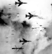 1966- U.S. B-66 Destroyer and four F-105 Thunderchiefs dropping bombs on North Vietnam