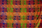 Cynthia Sands will demonstrate traditional African fabric stamping at the Smithsonian Holiday Festival this weekend. This process is used by Ghanaian artisans on a number of her textiles using Adrinka symbols.