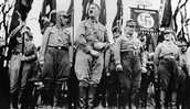 Hitler and his infantry, holding the Nazi flag.