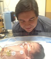 Daddy and baby at NICU.