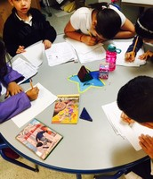 Ms. Annis' Math class uses manipulative and are reading and writing in Math