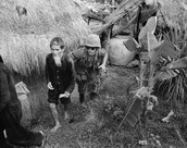1965- Marine moves an alleged Viet Cong activist