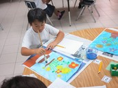"""Student working on rendition of Van Gogh's """"Sunflowers"""""""