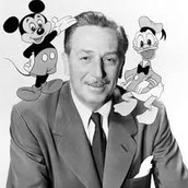 Walt posing with his big hits, Mickey Mouse and Donald Duck.