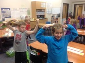 Addy and Josh put some muscle into demonstrating the word muscle!