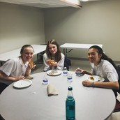 8B pizza party with Fr. Larry