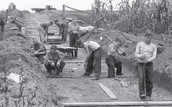 Men digging a channel