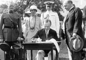 Calvin Coolidge signing the National Origins Act