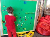 Makerpace-Zachary at the Lego wall
