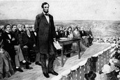 Abraham Lincoln addresses the Gettysburg Address.