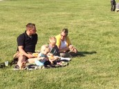 Families enjoying eating on the lawn!