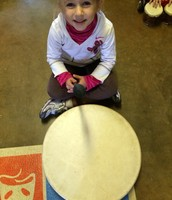 Which is bigger Olivia or the drum?