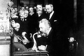 Alexander Graham Bell making a call to Tom Watson.