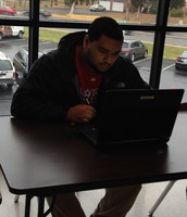 How might OneDrive help this student share his work with his teacher and his peers?