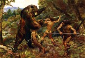 Native's hunting a massive cave bear