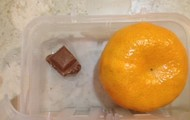 Mandarin and Square of Chocolate