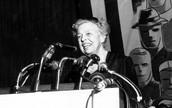 Eleanor Roosevelt speaking at a podium for Coalition of Labor Union Women