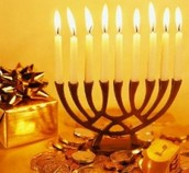 A picture of a Menorah at Hanukkah which is a tradition of Judaism