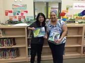 Carolyn Flores (Left) show off her book Canta Rana Canta