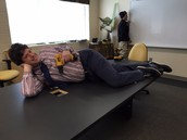 Mr. Lord modeling on the NEW conference room table!