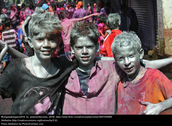 This is a picture of three kids that just got hit with white powder.