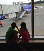 My kids waiting for our plane before their first flight!