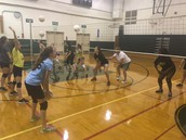 Volleyball practicing some passing drills.