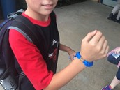 One of our Panthers shows off his Marathon Kids bracelet for finishing 4 marathons!