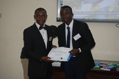 Samuel Elebute, a Literacy Fellow - receiving his certificate of fellowship from the Team Lead