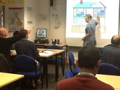Rachel with animated ESOL students enjoying their learning