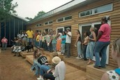 Communal gathering at a house rebuild