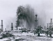 Oil blowing high into the air of Spindletop Hill