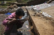 The reality of living in some countries is that kids drink the polluted water.