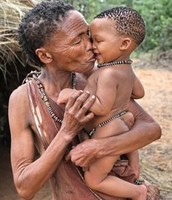 San Bushmen Elder taking care of Young while Parents are Hunting