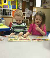 Zachary and Sofia working together one a puzzle