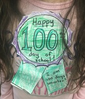 Our kindergarten Panthers showing off their 100th Day of School ribbons!