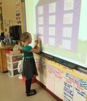 Tyler working on her Fact Families!