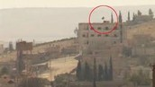 ISIS flag on top of a four story building in Kobani.