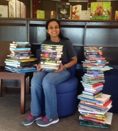 Mrs. Kumar with the books purchased from the book fair.