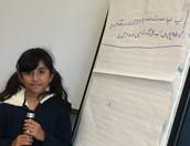 Amal showing us the Urdu alphabet!