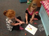 "Sierra and Addison playing ""Tic Tac Toe Sums in a Row"""
