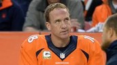 Manning watching the Broncos