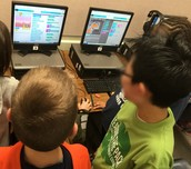 Wolff 5th Graders Checking Out a Newly Created Game