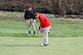 Jayson Schmitz lines up to finish up a hole at HIdden Valley Golf Course