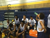 The Boys' Basketball team taking a little break.