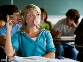 A student chewing gum in class.