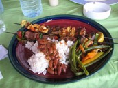 Kabob and rice, lentils, and vegetables