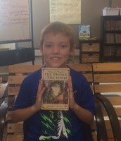 "Jackson showing off a book he ""buzzed"" about to the class."